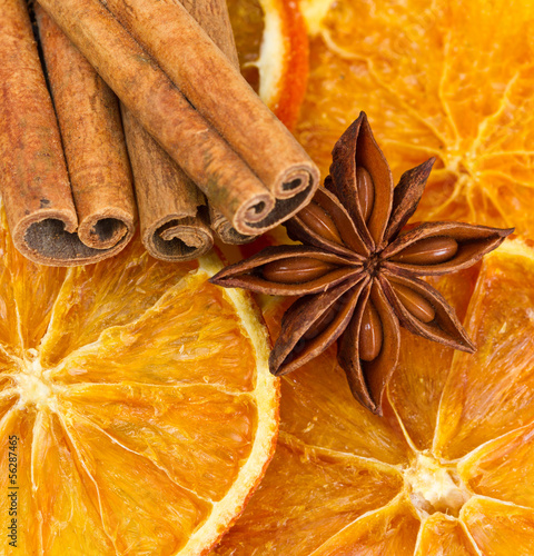 Cinnamon sticks, star anise and dried orange cuts © Lsantilli