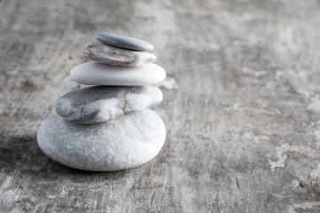 zen rocks on old wooden plank