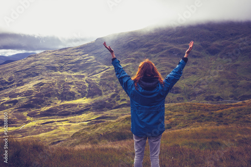 Young woman being one with nature on mountain top