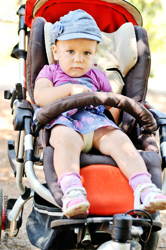 cute baby girl in stroller
