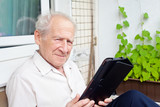 Old Man With a Touchpad PC