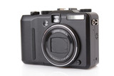 black digital compact camera isolated on white.