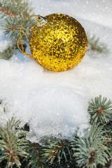 christmas ball on winter tree with snowfall