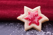 christmas star cookies with red jelly and powder sugar