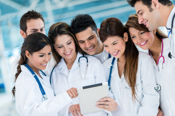 Doctors using health app on a tablet