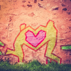 Tape Figures Forming a Heart as a Love Symbol on a City Wall