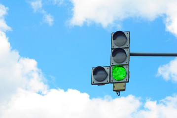 traffic lights on the background of sky and clouds