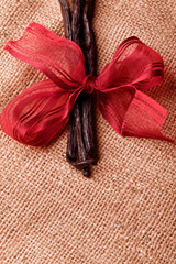 gourmet vanilla bean with red ribbon