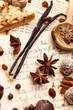 Zutaten zum weihnachtlichen  Backen auf einem Kochbuch