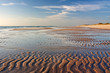 canvas print picture - Sandwatt mit Rippelmarken im Abendlicht am Weststrand von Sylt