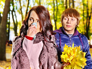 Couple sneezing  autumn outdoor.