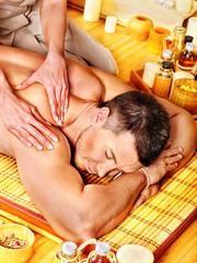 Man getting bamboo massage.