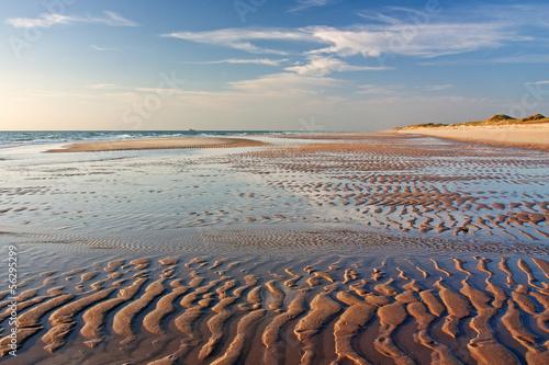 canvas print picture Sandwatt mit Rippelmarken im Abendlicht am Weststrand von Sylt