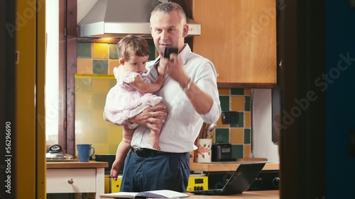 2of4 Multitasking business man and child, cooking, working