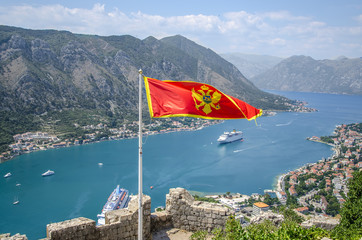 Flag of montenegro at kotor bay