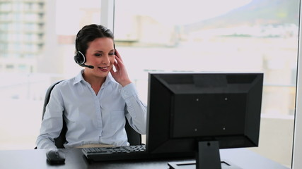 Call center agent on a call at her desk