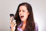Woman shouting to a cell phone