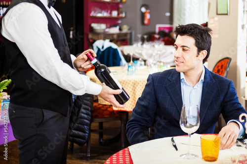 Man choosing a wine bottle