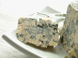 English Stilton cheese on white platter