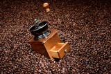 Coffee beans and an old hand grinder