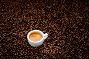 Coffee beans with white cup espresso. Background concept