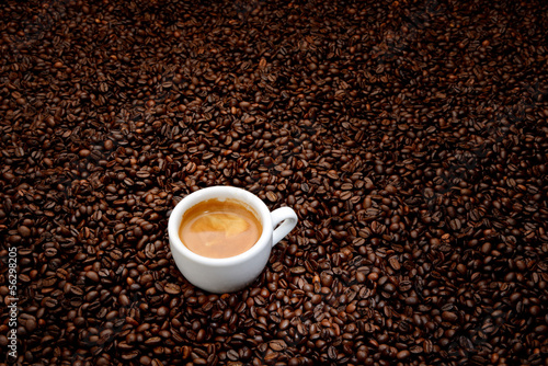 Fotobehang Cafe Coffee beans with white cup espresso. Background concept
