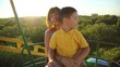 little boy with her mother on the Ferris wheel 4
