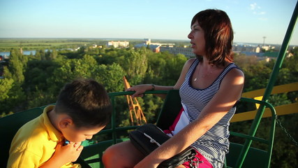 little boy with her mother on the Ferris wheel 2