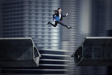Young asian businesswoman running on bridge