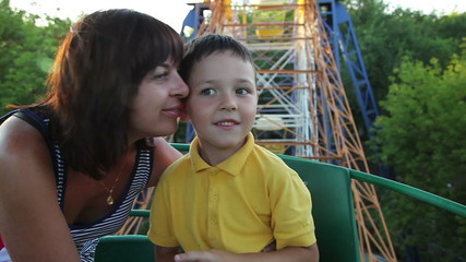 little boy with her mother on the Ferris wheel 1