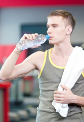 Man drinking water after sports