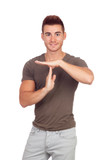 Attractive guy with spiky hair gesturing time-out