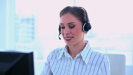 Smiling attractive operator making a phone call