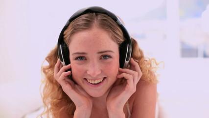 Cute blonde model enjoying music