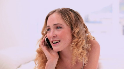 Laughing blonde model making a phone call