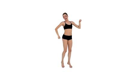 Dynamic brunette in sportswear dancing