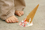 Dropped Ice Cream Cone by Child's Feet