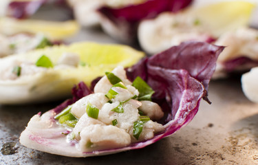 Fish ceviche on radicchio and arugula