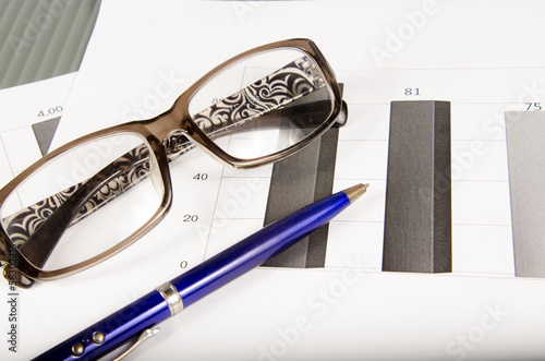 Pen, Glasses and Patient Form on desktop in business office.