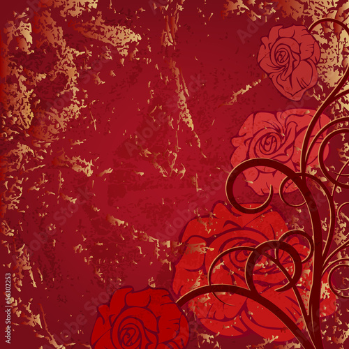 Beautiful corner vignette with red roses on the old background