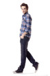 young casual man in checkered clothes full body walking