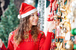 Beautiful Woman Buying Christmas Ornaments At Store