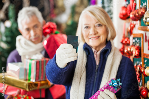 Woman Holding Credit Card At Christmas Store