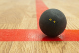 Double yellow dot squash ball on t-line.