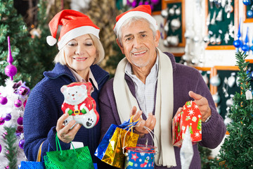 Man Shopping For Christmas With Woman In Store