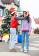 Boy Putting Santa Hat On Girl's Head