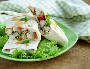 burrito (doner) with chicken and vegetables in pita bread
