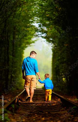 father and son together in railway green tonel