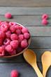 fragrant ripe raspberries in a ceramic bowl