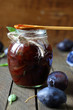 Plum jam in a glass jar